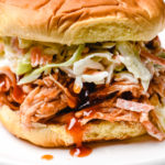 BBQ Chicken Sandwiches make an easy and delicious meal! Made with shredded chicken tossed in a flavorful BBQ sauce! Always a favorite! // addapinch.com
