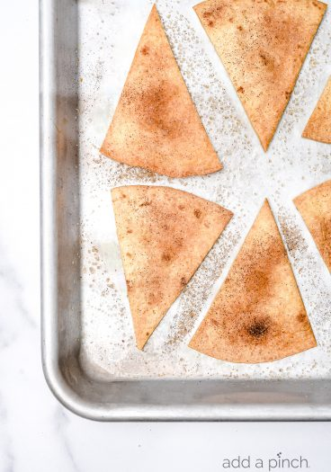 Cinnamon Sugar Tortilla Chips make a quick and easy recipe perfect for serving with your favorite sweet dips, salsa, or ice cream! Made with 4 ingredients and ready in minutes! // addapinch.com