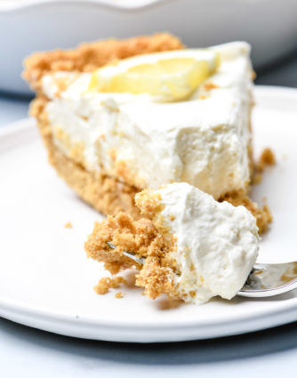 This no bake lemon cream pie is a quick and easy twist on the classic. Made with cream cheese, cream, and lots of lemon with a buttery graham cracker crust. // addapinch.com