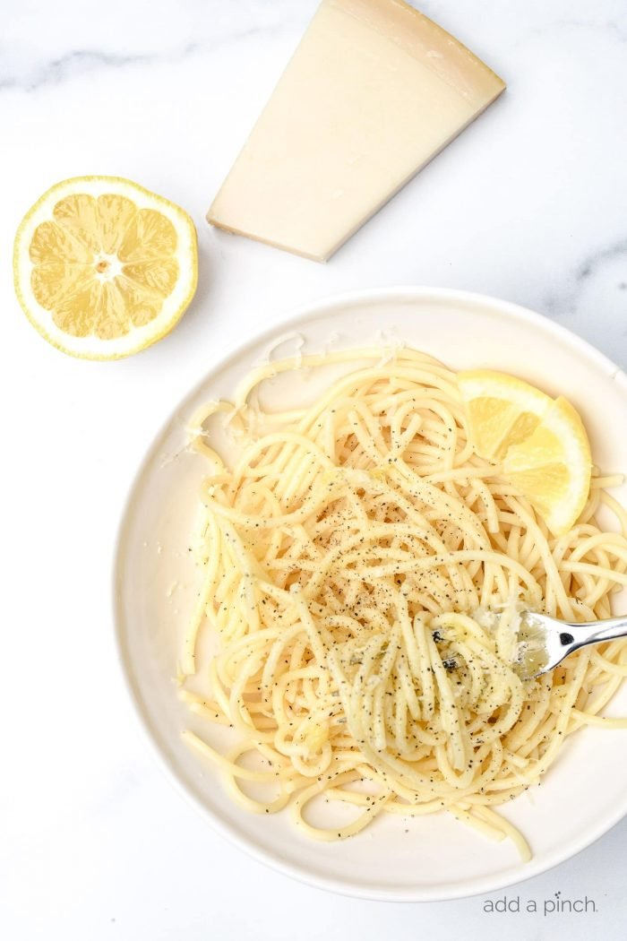 This Lemon Parmesan Pasta Recipe is a quick and easy pasta recipe that makes the perfect back pocket recipe for busy weeknights. Ready in less than 15 minutes! // addapinch.com