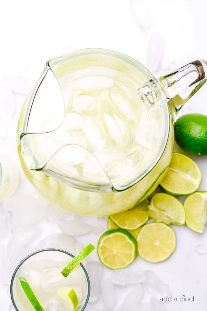 Limeade makes a refreshing drink, especially in the summer. Made of limes, sugar, and water, this limeade recipe is a keeper! // addapinch.com