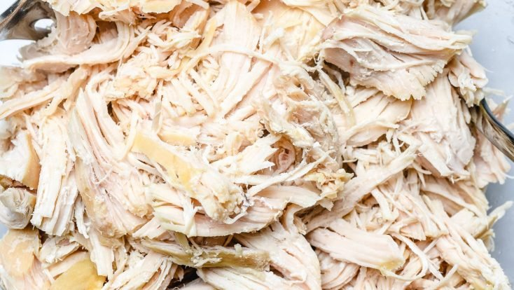 This Easy Shredded Chicken recipe makes meal prep even easier! Made with just two ingredients, you can customize to use in so many ways! // addapinch.com