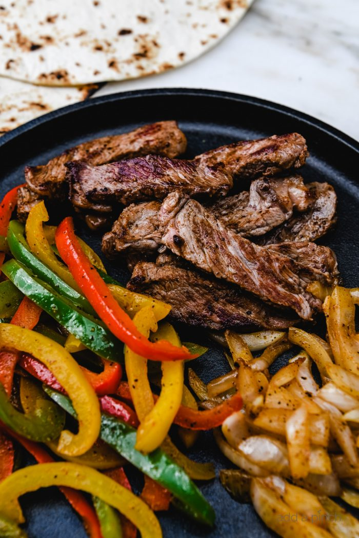Rib Eye Fajitas Recipe - Ribeye Steak Fajitas are so quick, easy and flavorful! Made with perfectly seasoned, tender Ribeye steak, bell peppers and onions, they are always a favorite! // addapinch.com