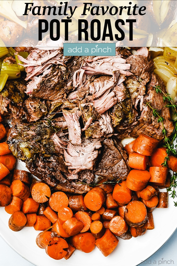 Pot Roast on platter surrounded by carrots, potatoes, celery, onions - with text - addapinch.com