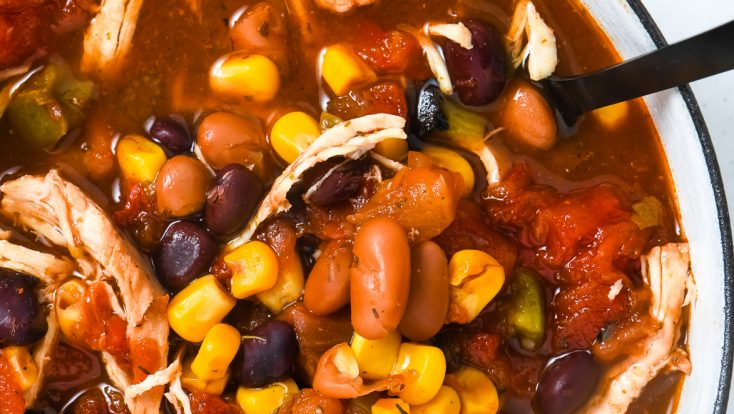 Chicken Taco Soup Recipe - So quick and easy, this chicken taco soup recipe is flavorful and delicious! Made with chicken, beans, corn, it is on the table in less than 30 minutes! // addapinch.com
