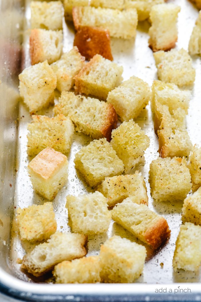Learn how to make easy homemade croutons from scratch with this simple croutons recipe. They make the perfect for topping salads, soups and more! // addapinch.com