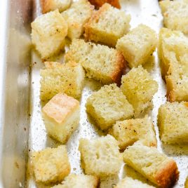 Learn how to make easy homemade croutons from scratch with this simple croutons recipe. The make the perfect for topping salads, soups and more! // addapinch.com