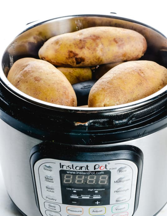 """Instant Pot """"Baked"""" Potatoes make a quick and easy way to prepare baked potatoes! Ready in less than 30 minutes! // addapinch.com"""