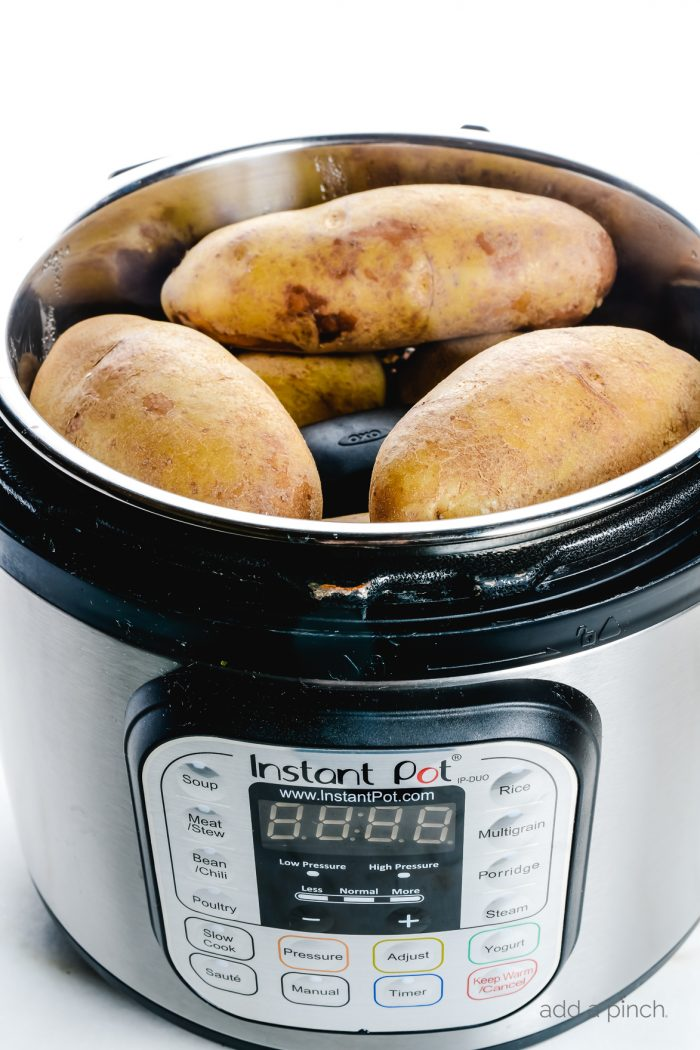 "Instant Pot ""Baked"" Potatoes make a quick and easy way to prepare baked potatoes! Ready in less than 30 minutes! // addapinch.com"