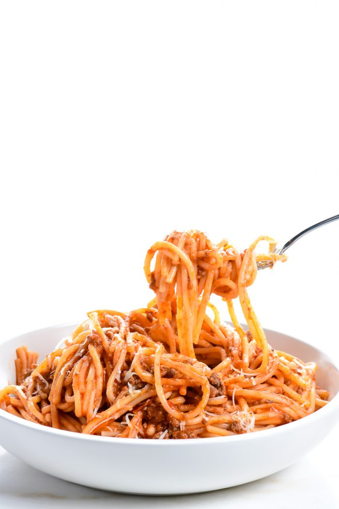 Spaghetti makes a favorite weeknight meal and this quick and easy Instant Pot Spaghetti recipe makes it even easier! Ready in 30 minutes! // addapinch.com