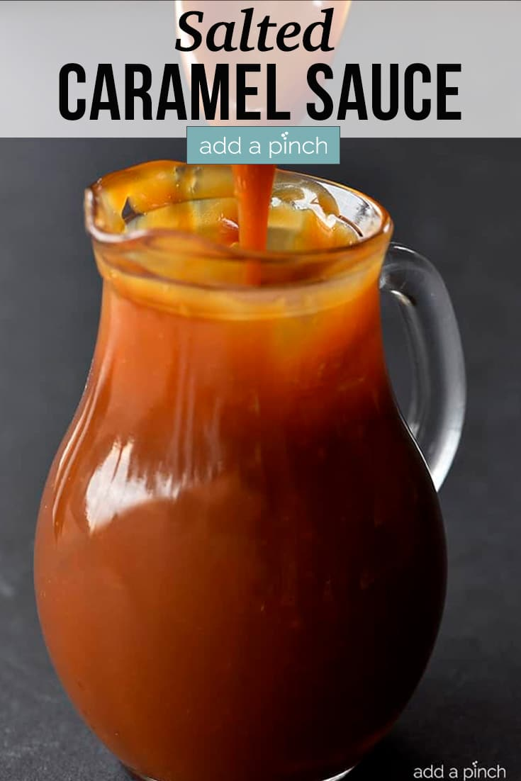 Salted Caramel Sauce in glass pitcher, being drizzled in with with a spoon - with text - addapinch.com