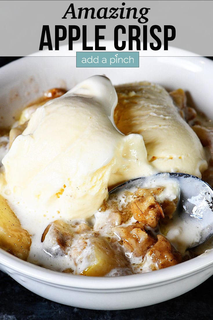 Bowl of Apple Crisp topped with vanilla ice cream - with text - addapinch.com