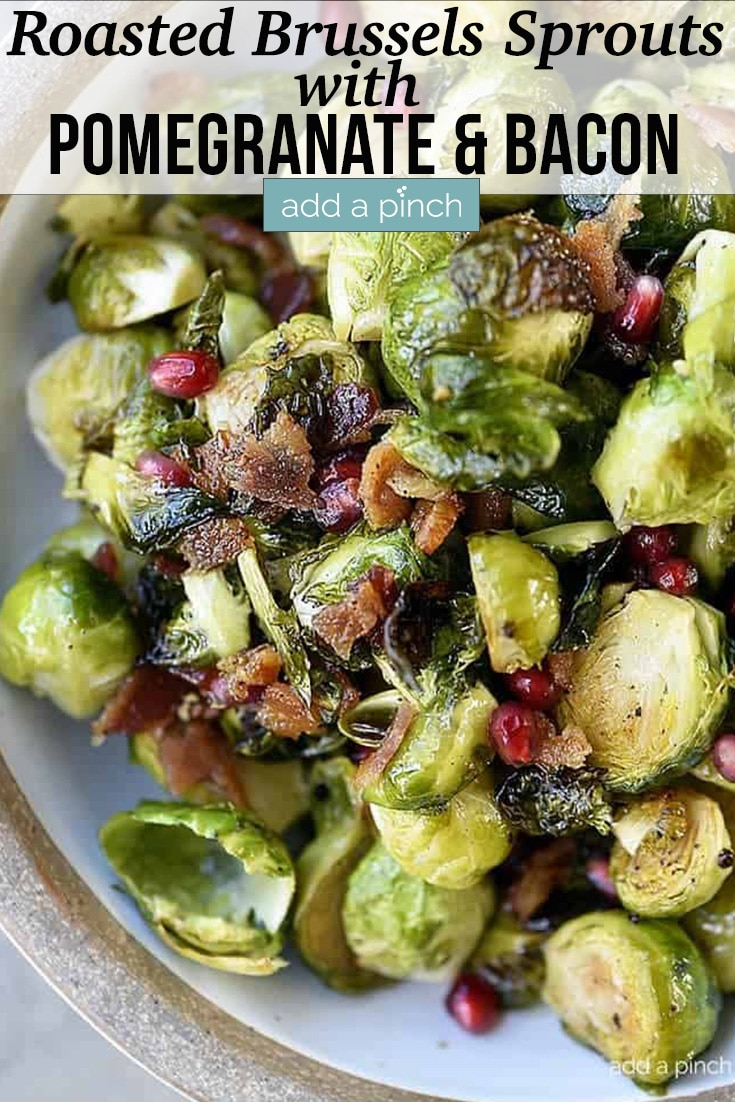 Roasted Brussels Sprouts with Bacon and Pomegranate in white serving dish - with text - addapinch.com