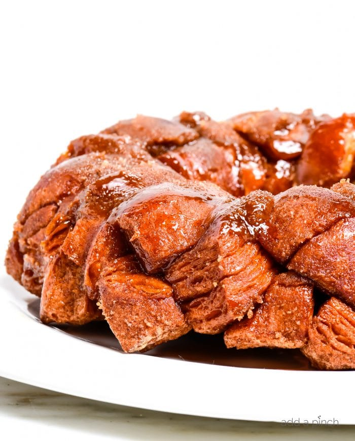 Photograph of easy monkey bread on a white plate on a marble table. // addapinch.com