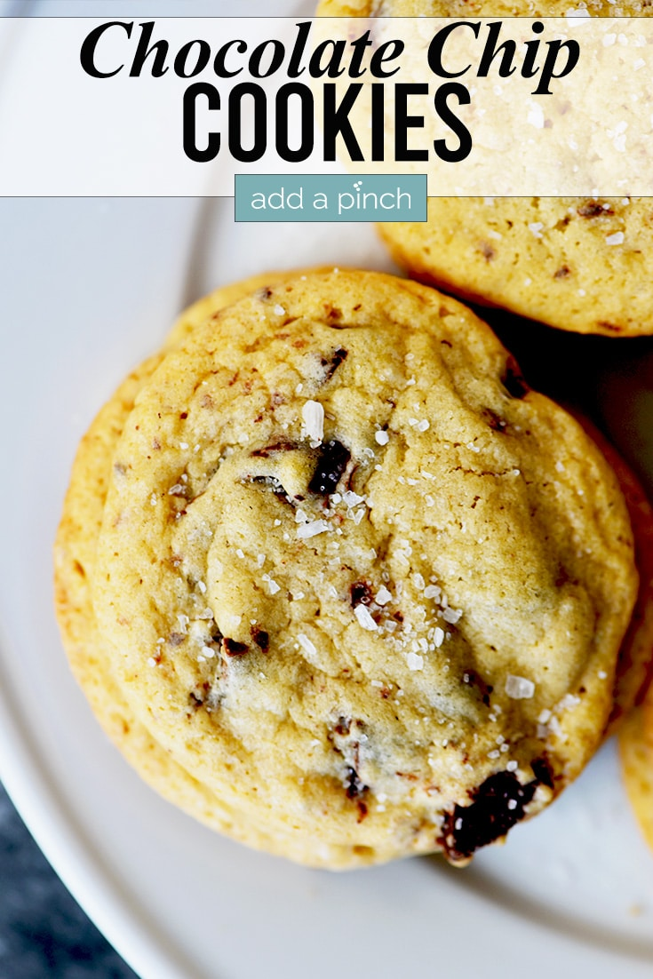 Salted Chocolate Chunk Cookies on a plate photo with text - addapinch.com