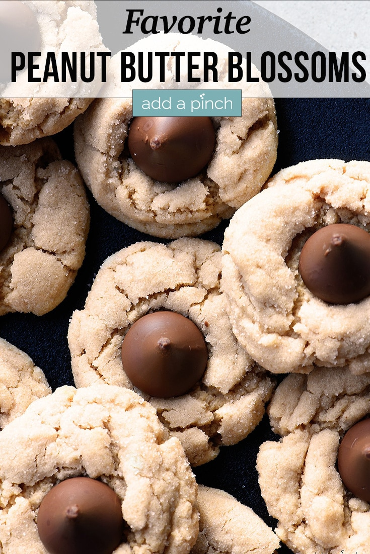 Peanut Butter Blossoms cookies on a serving tray - with text - addapinch.com