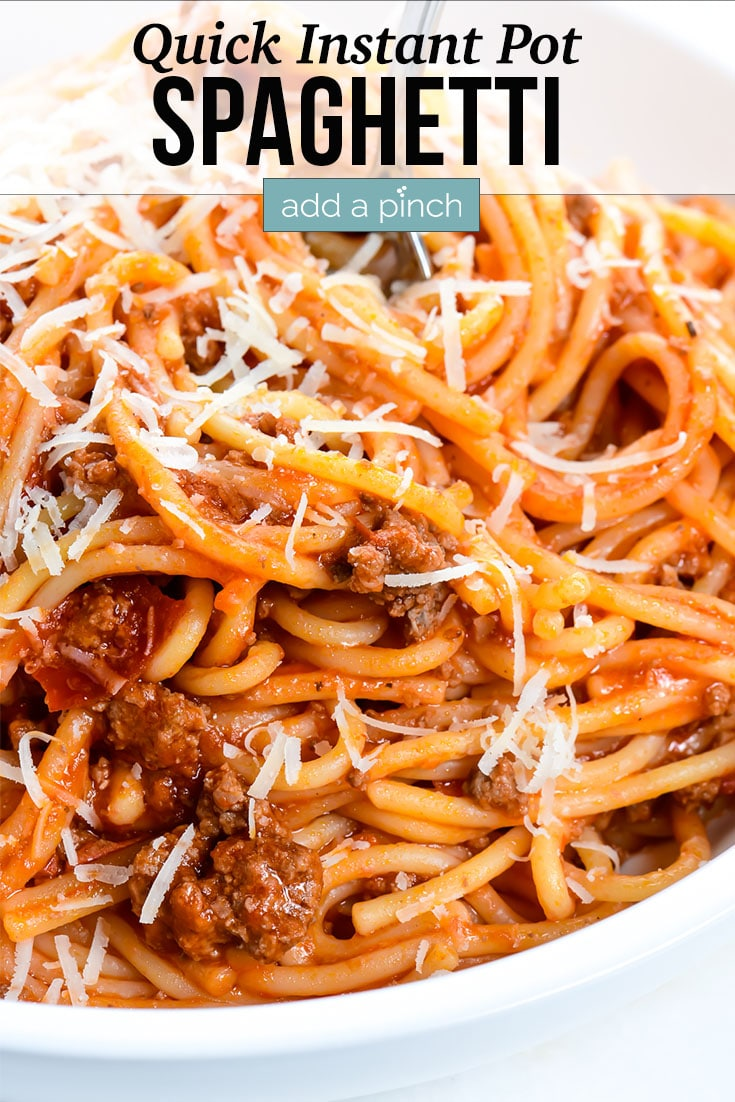Spaghetti with fork in bowl photo with text - addapinch.com