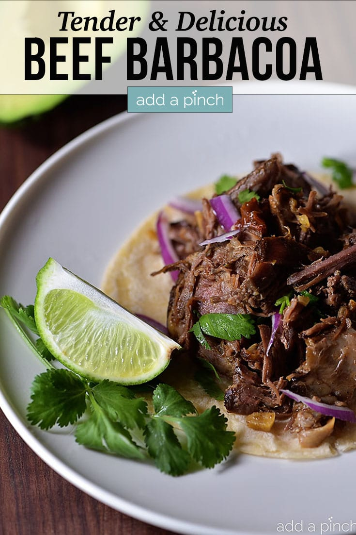 Beef Barbacoa on tortilla with slice of lime and text - addapinch.com