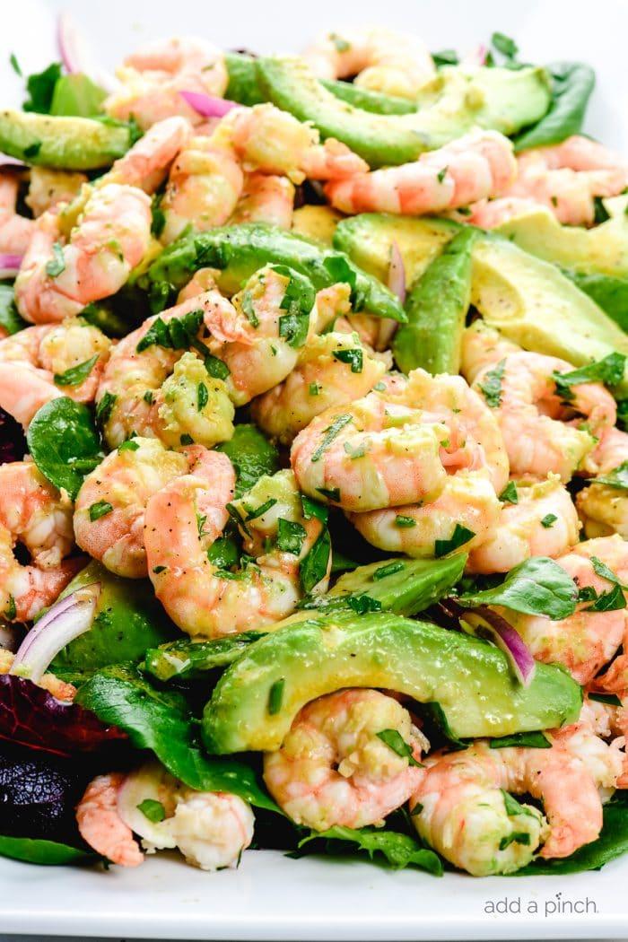 Citrus Shrimp Avocado Salad on a white platter on white marble.
