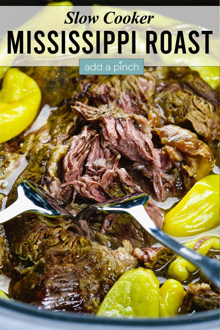 Slow Cooker Mississippi Roast shredded and topped with pepperoncini peppers - with text - addapinch.com