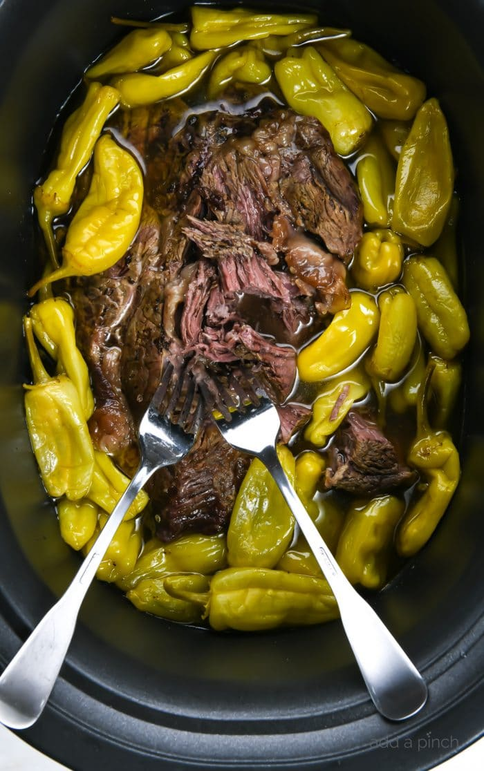 Photograph of Mississippi Roast in a slow cooker.