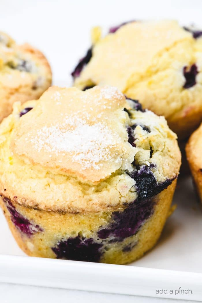Blueberry muffins on a white platter
