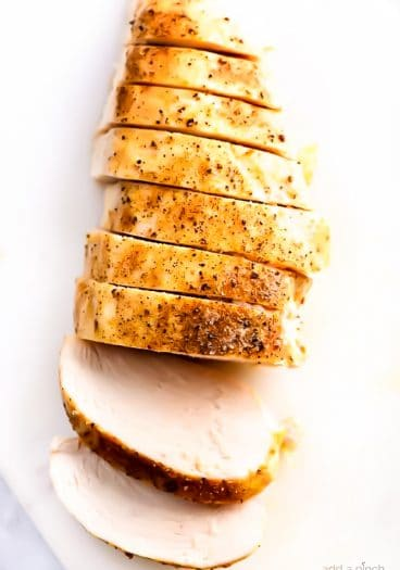 Baked chicken breast on a white board