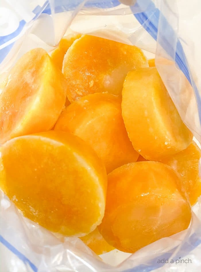 Photograph of frozen eggs in a freezer safe bag to demonstrate how to freeze fresh eggs. / addapinch.com