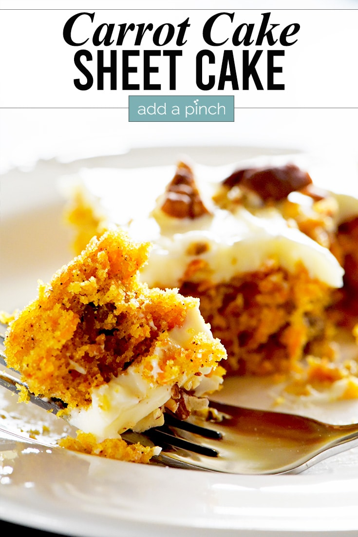 Bite of carrot cake topped with cream cheese frosting on a white plate. | addapinch.com