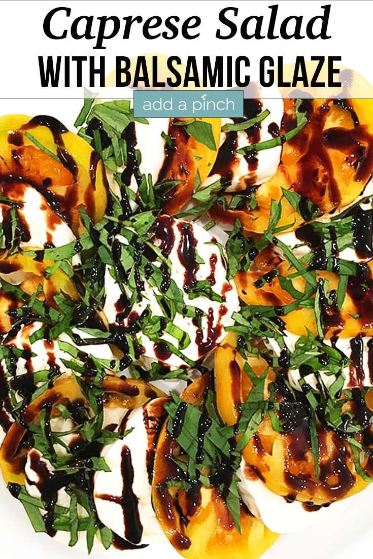 Caprese Salad with heirloom tomatoes, mozzarella slices, basil ribbons and Balsamic Glaze - with text - addapinch.com