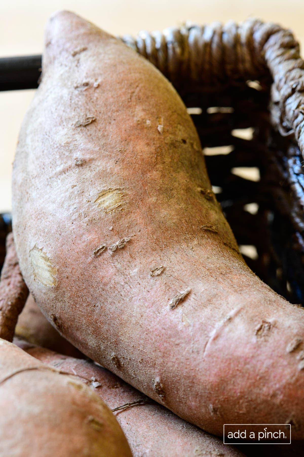 Closeup photo of a sweet potato in a wicker basket.