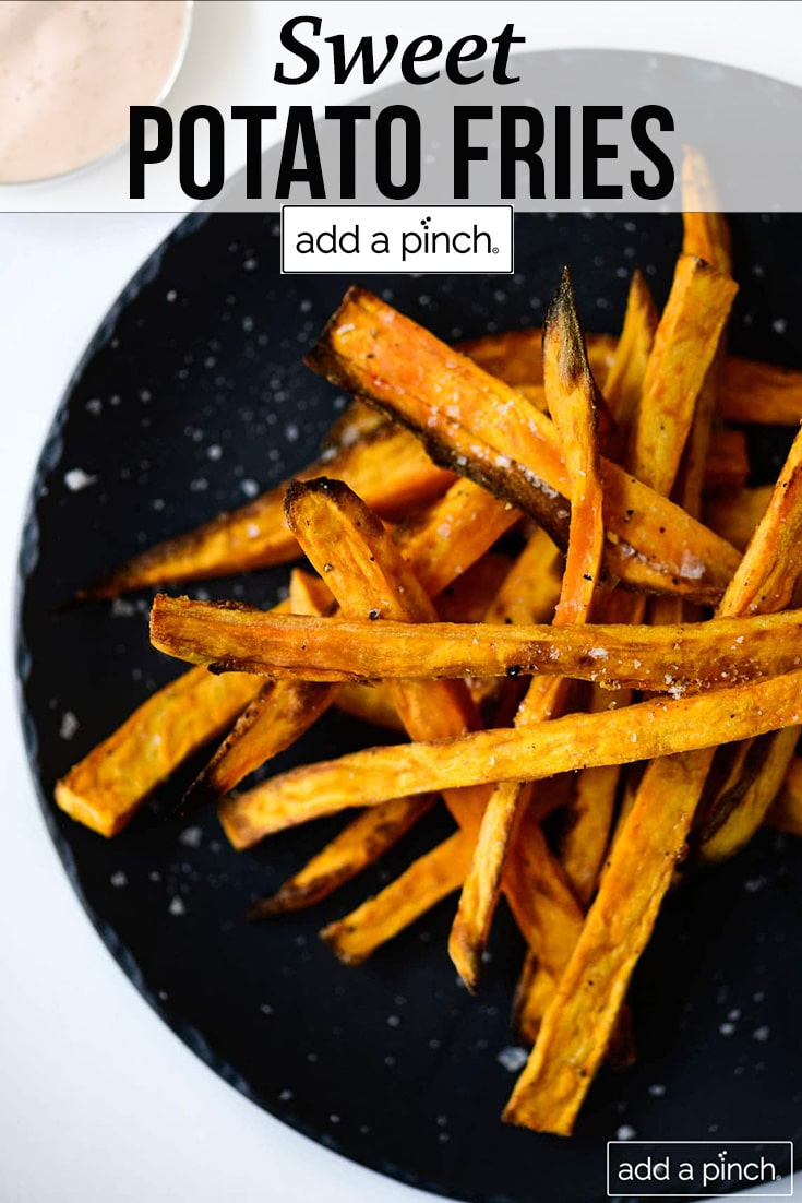 Black plate with sweet potato fries sprinkled with sea salt - with text - addapinch.com