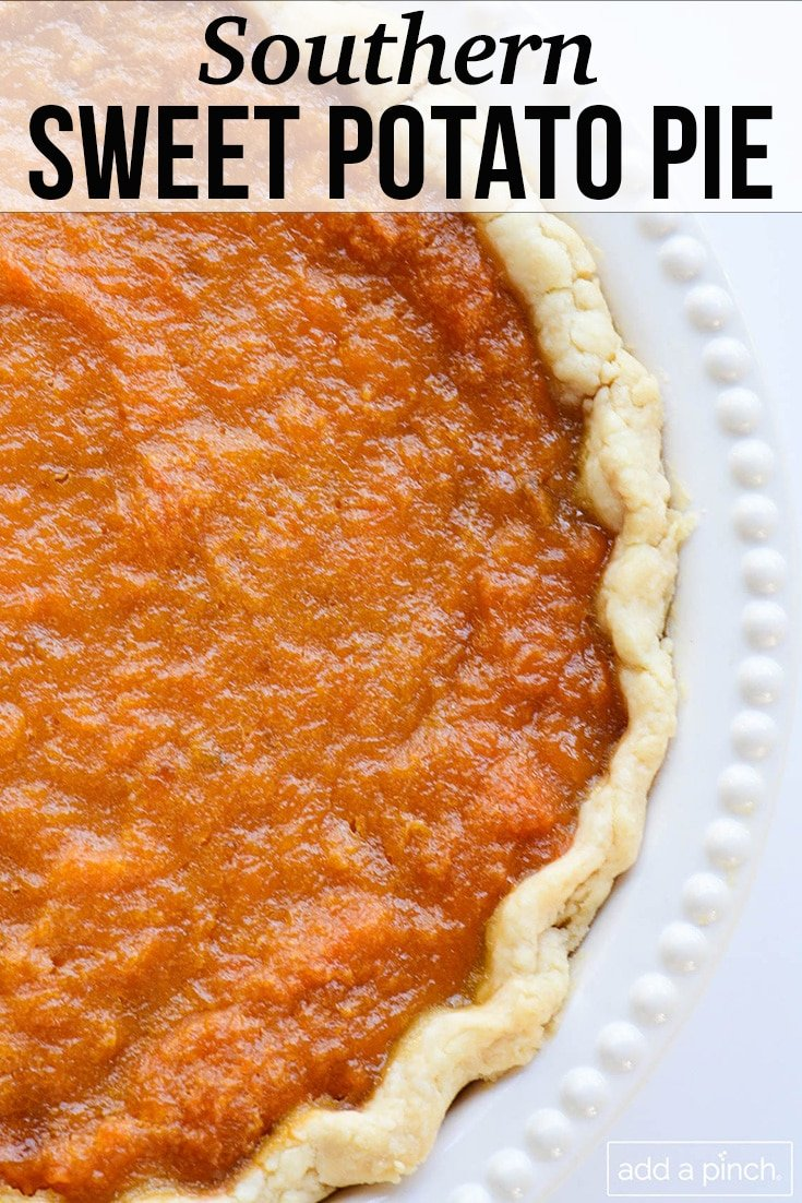 Whole sweet potato pie on white beaded edge pie plate - with text - from addapinch.com